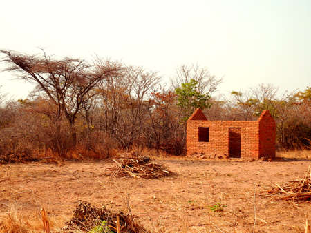 Little side road brick house under construction in Zambia