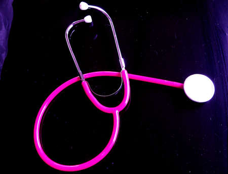 pink stethoscope in black Stock Photo