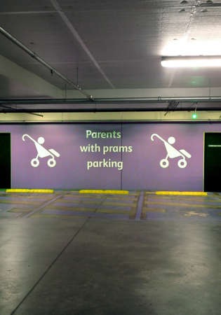 special parents with prams parking reserved space on an underground public car park Stok Fotoğraf