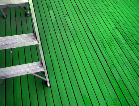 Painted deck and aluminum stepladder Stock Photo