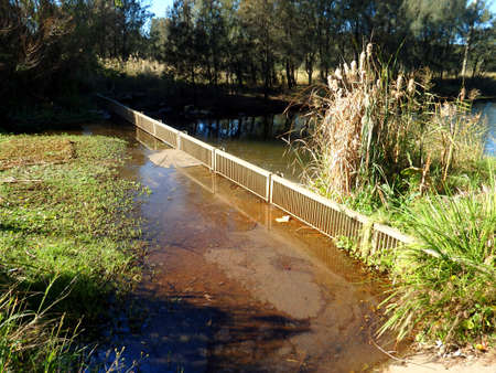 Small metallic grid filter of rainwater going to waterways Фото со стока