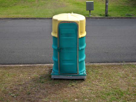 Portable TToilet Hired on a public suburban street set near a park.