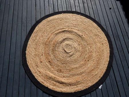 round rug on dark floor