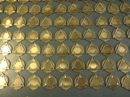 Medals round and triangular being made in a medallion factory