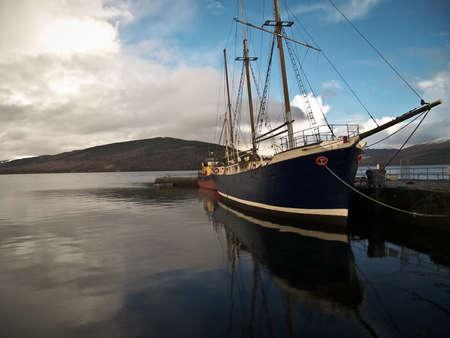 highlands: A ship in a harbour in Scottish Highlands