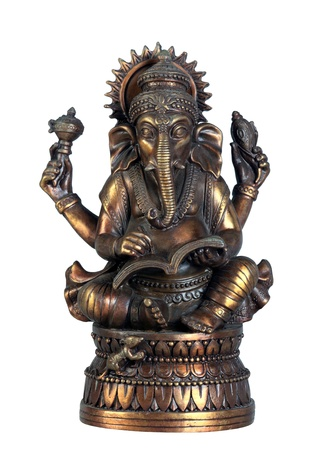 Old bronze statuette of hindu God Ganesha with book isolated on white Stock Photo