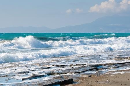 Wild stony beach of Aegean Sea at Rhodes  Greece