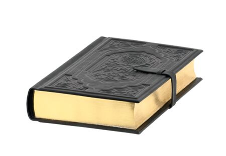 Closed holy Koran book isolated on white background photo