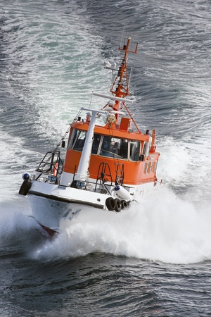 Clipping Norwegian pilot boat at the sea