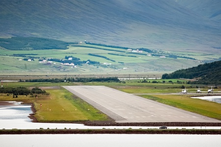 View of airport runway at Akureyri  Iceland  from sea side