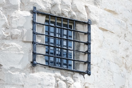 Fragment of old castle with window and bars Stock Photo - 12680475