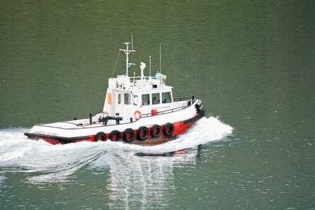 tug boat: Harbor tug boat  hurrying on business at seaport