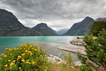 Scenic view of mountain lake at Geirangerfjord area  Norway