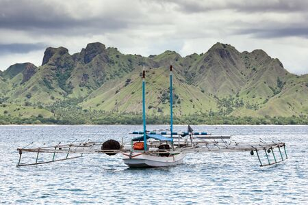 komodo island: Scenic seascape with fishermen boat, Komodo Island  Indonesia  Stock Photo