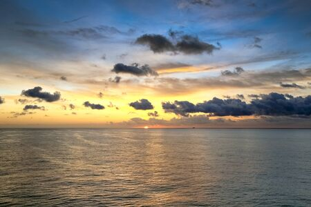 Scenic view of sunrise in ocean from deck of cruise ship photo