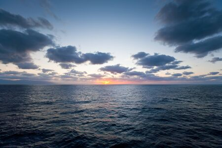 crepuscular: Sunset in  Atlantic ocean from the deck