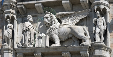 Sculptures of Doge and Winged Lion of St. Mark on Doges Palace, Venice (Italy).   Stock Photo