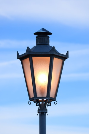 Lantern glowing in morning twilight, San Marino (Italy) Stock Photo
