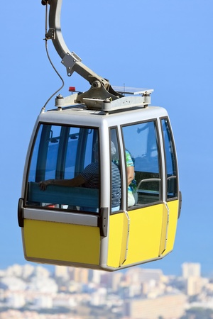 Cabin of aerial cableway with tourists at Costa del Sol resort, Benalmadena (Spain) Stock Photo