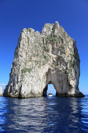 Faraglioni di Mezzo  - one of three famous giant rocks, Capri island (Italy)