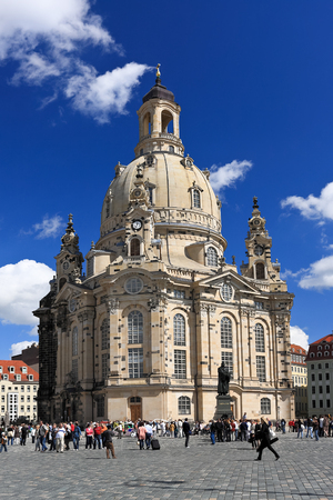 DRESDEN, GERMANY - AUGUST 23, 2008: Tourists visiting the sights - the Frauenkirche cathedral (Church of Our Lady or Mother of God Church). It is a Lutheran church in Dresden, the capital of the German state of Saxony. Editorial