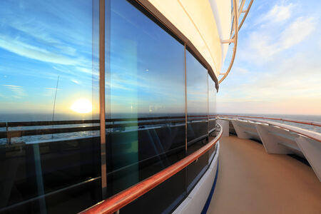 handrail: Scenic view of sunset from the deck of ocean ship Stock Photo