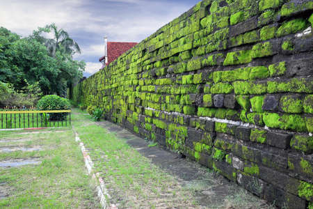 Old wall of the Fort Rotterdam covered with green moss, Makassar   Indonesia  Stock Photo