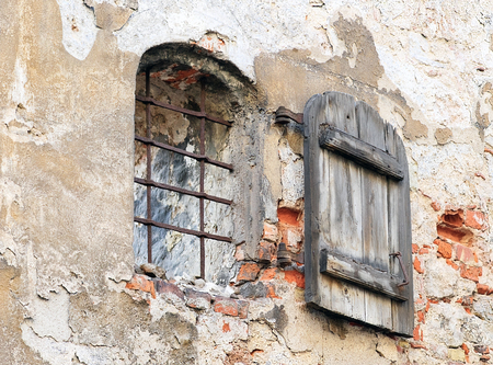 ramshackle: Window with shutter on the ancient wall, Riga (Latvia). Image assembled from few frames