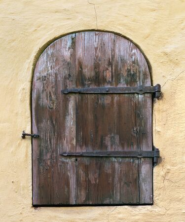 Old wooden door in the wall Riga Latvia. Image assembled from few frames