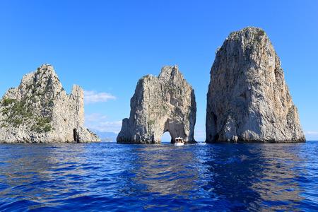 Faraglioni - three famous giant rocks, Capri island Italy