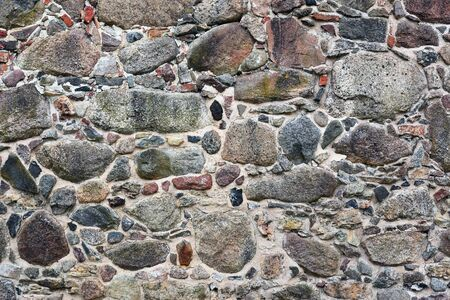 rundale: The surface of the wall made of natural stone, Rundale - Latvia Stock Photo