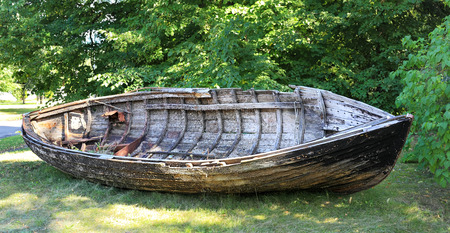 Old fishing boat lying on the shore, Lielupe - Latvia