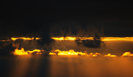 Sunset light of the sun breaks through the clouds. Special image processing