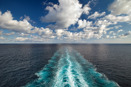 Ocean view from the deck of a ship with wake trace