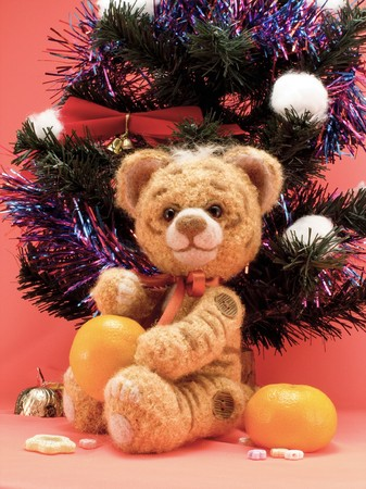 Toy knitting tiger with oranges under a fur-tree Stock Photo - 6964767