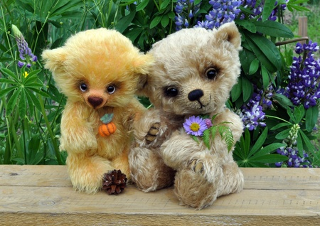 Handmade, the sewed toys: two friends teddy-bears among flowers photo