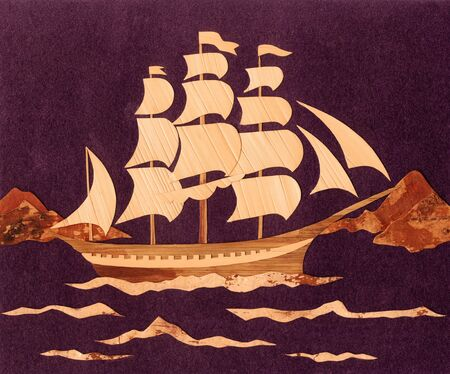 Application: the ship from straws and an underside of a birch bark against from a black velvet photo
