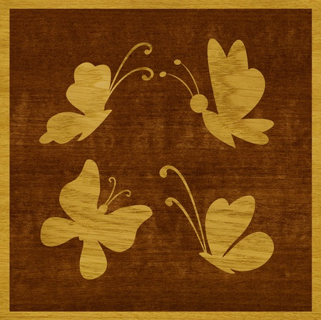 Marquetry, butterflies of ash wood veneer against the background of makore wood photo