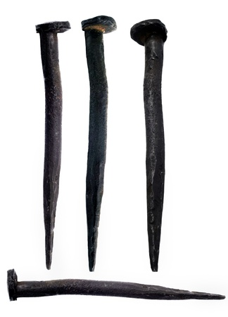 Old hand-forged nails, manufactured in Siberia, Russia, in the mid-20th century Stock Photo - 12173612