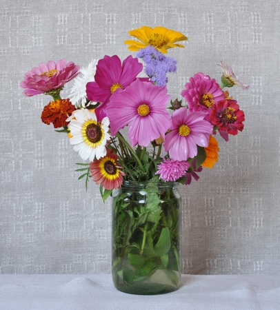 Bouquet garden flowers on the background of an old linen canvas  August, the Central Russia photo