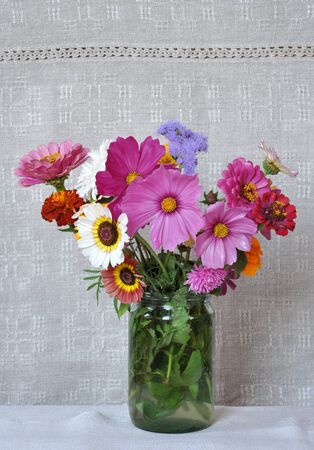 garden marigold: Bouquet garden flowers on the background of an old linen canvas  August, the Central Russia