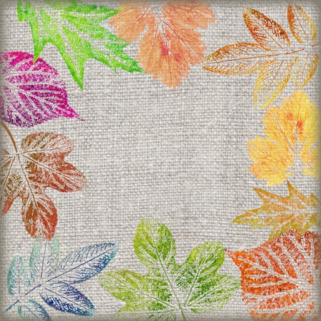 Abstract artistic background, hand draw, various painted colored leaves on a linen canvas