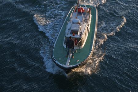 pilot light: pilot boat Editorial