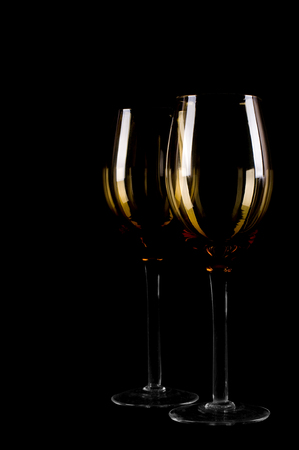 Wine glass silhouette on black background