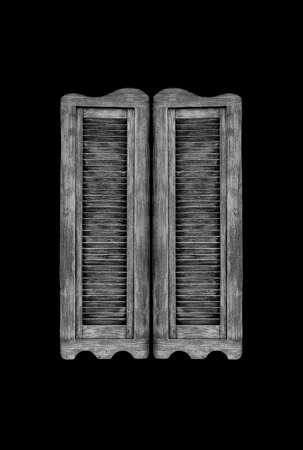 Old wooden western swinging Saloon doors isolated on black background  photo