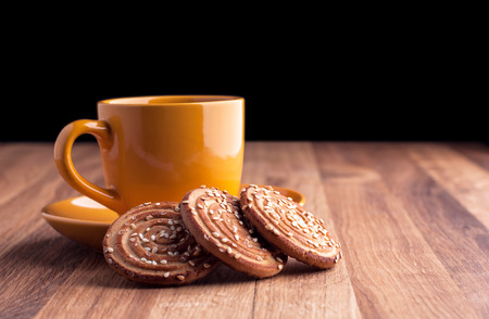 Colorful cup of coffee and cookies   photo