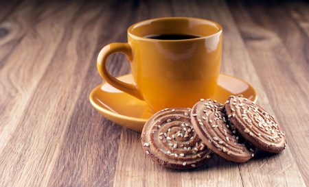 Colorful cup of coffee and cookies on wooden background  photo