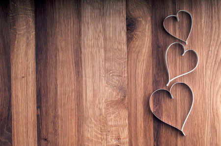 Valentine s day paper hearts on wooden background   Banco de Imagens