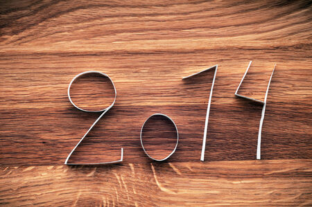 2014 Happy New Year paper digits on wood   photo