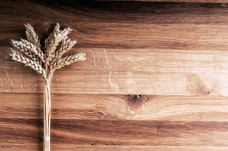 Bundle of wheat on wooden background  Stock Photo